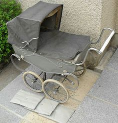 Silver Cross grey pram  ---   I was pushed around in this as a baby.