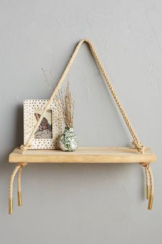 Teak Swing Shelf - anthropologie.com. DIY inspiration.