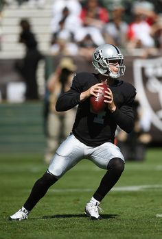 Derek Carr  4 of the Oakland Raiders drops back to pass against the Houston  Texans f2419dc78