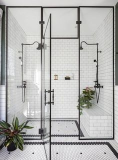 industrial black + white shower | modern and minimal bathroom style inspiration | home and interior styling ideas | minimalist subway tile washroom with green plants