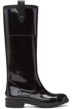 Tall glossy rubber rain boots in black. Round cap toe. Leather pull-loops featuring star-shaped studs at collar. Rubberized logo at heel. Tonal treaded rubber sole. Tonal hardware. Tonal stitching.