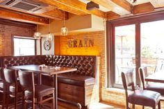 Granary Tavern.  Best bar in the Financial District/Waterfront area.  Good upscale pub grub, good beers, patio overlooking the Rose Kennedy Greenway, exposed brick interior provides great backdrop.