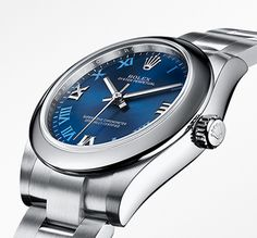 'The roman numerals on the blue dial of the Rolex Oyster Perpetual 31 alternate between 18 ct white gold appliques and striking blue, printed hour markers.