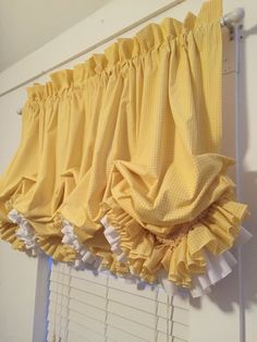 A personal favorite from my Etsy shop https://www.etsy.com/listing/459761496/yellow-gingham-double-ruffle-balloon