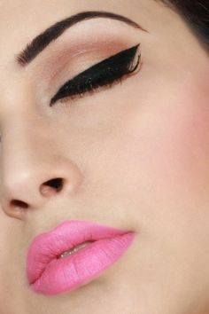 perfect winged eyeliner, perfect brows, flawless skin and a pink lip