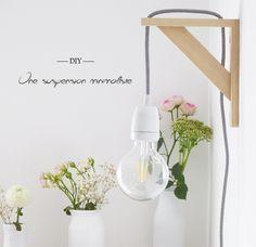 Je vous explique dans ce billet le pas à pas pour réaliser une suspension minimaliste, un diy tout simple avec très peu de matériel pour un rendu très épuré