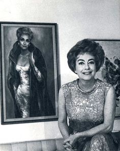 Joan with her Margaret Keane portrait. Keane was famous for painting sad, big-eyed children and women, making her the perfect artist for Crawford's somber, big-eyed visage. Crawford was a great admirer of Keane's work and owned several of her paintings.