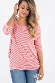 Soft and stretchy top featuring a dolman sleeve fitted waist for versatile wear.