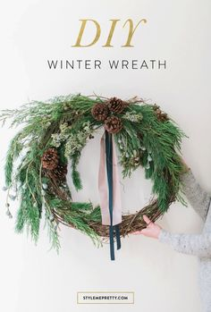 How to make a DIY winter wreath perfect for the holidays! http://www.stylemepretty.com/living/2016/12/21/up-your-cold-weather-curb-appeal-with-this-diy-winter-wreath/
