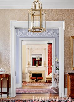 An ornamental frieze embellishes the upper walls of an anteroom that links the foyer and the living room. - Photo: Emily Jenkins Followill / Design: Carolyn Griffith