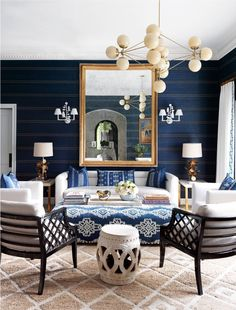 Modo Chandelier - 4 Sided , 15 Globes (Brass/Cream) - Palm Beach, FL. Interior by Jeff Lincoln. Image by House Beautiful. Light designed by Jason Miller for Roll & Hill