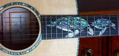 This Taylor Living Jewels Sea Turtle guitar is insane.