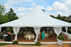 """Wedding Photos   Fairy Tale Tents & Events - 40'x40' High-Peak Fairy Tale Frame Tent with white side pole swags with white ties, and full tent flooring; 60"""" round tables with ivory table linens and gold chiavari chairs and ivory chair pads"""