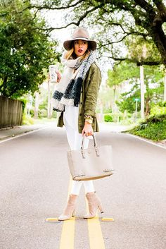 green utility jacket + white shirt + white skinny jeans + blanket scarf + ankle boots