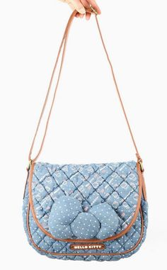 Get noticed with our Hello Kitty chambray crossbody bag