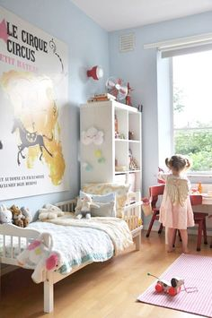 very soft blue on the walls of a little girl's room full of pale colors and white keep it bright and pleasant