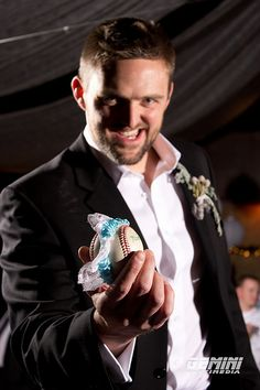 """""""Who's gonna catch it?""""  The groom was a baseball player, so when he tossed the garter he wrapped it around a baseball. Great idea!  We could do a street hockey ball!"""