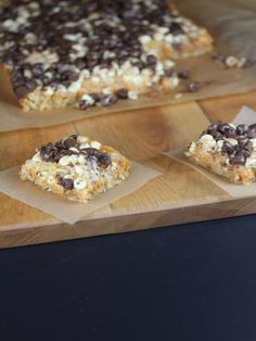 A simple magic cookie bar is made perfect for fall by adding pumpkin to make them magic pumpkin bars.