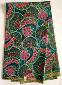 A personal favorite from my Etsy shop https://www.etsy.com/listing/509090983/african-print-fabric-ankara-green-pink