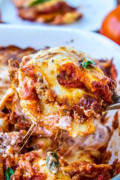 Easy Cheesy Ravioli Lasagna from The Food Charlatan // Hearty no-brainer dinner to make on busy back-to-school nights. It's a total crowd-pleaser! And a great make-ahead meal too.