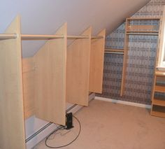 """Attic closet; like the """"stepped"""" hanging storage at end of wall, making most of tall wall."""