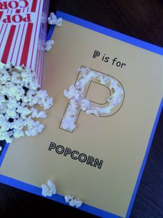 """From Lucinda Plummer at Spreckels Sprouts Daycare: """"P"""" is for POPCORN - Letter art for preschool learning.   This art project was fun and also reinforced our lesson plan!   I made my own template on the computer, printed on yellow paper, kids used glue sticks to paste that to construction paper, finally they glued on popcorn with Elmers glue.  Easy & fun!  :)"""