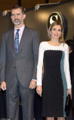 King Felipe and Queen Letizia admire the works of art in the white-walled Madrid exhibition space.