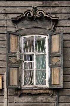 Ornate old wooden windows in house a in Irkutsk, Russia