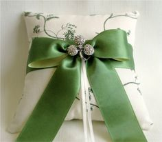 Sparkling Emerald Ring Bearer Pillow - ivory and green tolie with satin ribbon and a vintage shamrock brooch. Perfect for an Irish wedding!