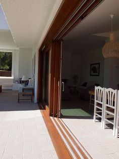 Like the way the doors slide behind each other Living Room Sliding Doors, Wooden Sliding Doors, Sliding Glass Door, Glass Doors, Dover House, Door Design, House Design, House Plans South Africa, House Doors