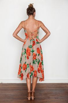 Love the open back of this dress, and color.