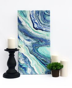 Beautiful array of blues in this vertical pour painting.