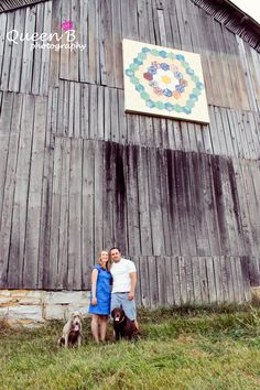 with their dogs and a barn with quilt pic