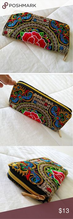 🎉SALE 🎉New Floral Colorful Wallet New black wallet. Very cute floral design with a bunch of nice colors. Also has a nice gold zipper very spacious can fit your cards phone or money inside. Very cute new never used. Design follows all around the wallet . Bags Wallets
