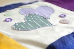 Another lovely Patchwork Quilt square made at a #BabyShower Workshop. Love the #appliqué hearts! #TheCraftyHen