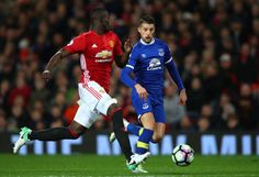 Kevin Mirallas of Everton attempts to take the ball past Eric Bailly of Manchester United during the Premier League match between Manchester United...