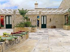 Relais Masseria Capasa is a sumptuous hotel with stone walls surrounded by beautiful olive trees in Martano, Italy and designed by Paolo Fracasso.