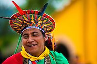 """A native from the Kamentsá tribe, wearing a colorful headgear, smiles during the Carnival of Forgiveness, a traditional indigenous celebration in Sibundoy, Colombia, 12 February 2013. Clestrinye (""""Carnaval del Perdón"""") is a ritual ceremony kept for centuries in the Valley of Sibundoy in Putumayo (the Amazonian department of Colombia), a home to two closely allied indigenous groups, the Inga and Kamentsá. Although the festival has indigenous origins, the Catholic religion elements have been…"""