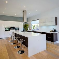 Futuro Streamline Illuminated Designer Island Range Hood In A Contemporary Kitchen B Y Aran