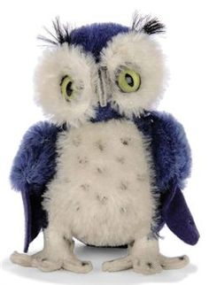 A STEIFF BLUE MOHAIR WITTE UHL, (4314?), green and black plastic eyes, white mohair eye surrounds and front, swivel head, blue felt wings, white felt feet and script button, 1960 --5in. (13cm.) high