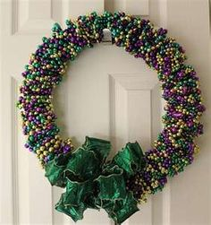 Mardi Gras wreath... I never know what to do with these beads... Such a great idea!
