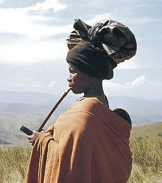 Africa   Xhosa woman with infant and smoking traditional pipe.  South Africa   Date and photographer unknown.
