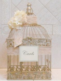 Your vintage theme calls for delicate flowers and pastel colors. Bird cages have been a popular option for card boxes and all you need to do is glam it up with ribbons or flowers of your choice. - See more at: http://www.quinceanera.com/decorations-themes/card-box-ideas-quinceaneras/?utm_source=pinterest&utm_medium=social&utm_campaign=decorations-themes-card-box-ideas-quinceaneras#sthash.hXNVUwEm.dpuf