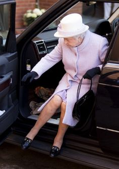 Queen Elizabeth II Gets Out A Range Rover Car As She Arrives At Newbury Racecourse Event