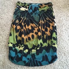 Strapless multi color animal print Strapless, multi color animal print top, silky feel Charlotte Russe Tops