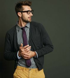 Richards - dark rimmed glasses, grey cardigan, striped maroon tie, black and white gingham, ochre pant