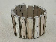 Accordion Bracelet by Nancy Hubert - Sterling silver with fossilized wolly mammoth ivory. $2700 - Google Search