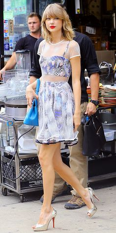 Taylor Swift delivered an impeccable off-duty look with a Novis design—a printed bustier and matching skirt with a sheer white overlay—styled with a dark teal Bulgari handbag and mirrored Christian Louboutin peep-toes