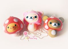 I'm not sure what these things are on the necklace, but they are adorable and wearing mushroom costumes. Squishy Rilakkuma in a Mushroom Suit Necklace by UberTiny on Etsy, $3.99