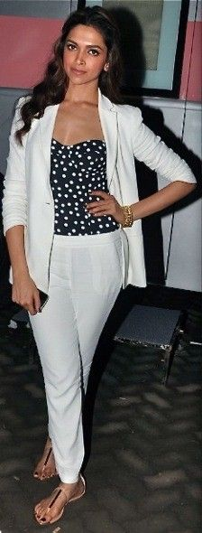 #KitschSpotted: Deepika Padukone wearing a polka dot Dolce and Gabanna bodysuit under a casual yet chic white blazer with matching white pants.